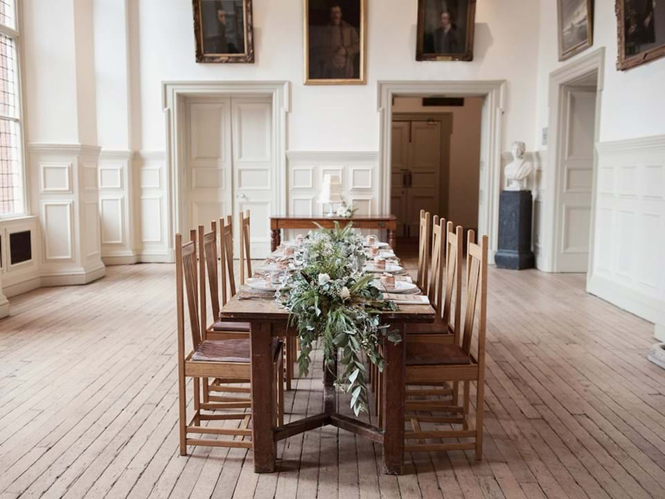 Photo of a long dinner table set up in the Main Hall