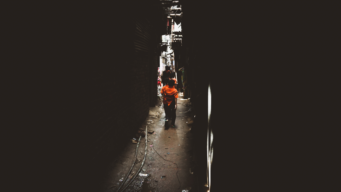 Two children walk down the narrow alleyways separating the buildings in Bhola. Image by Tasfiq Mahmood.