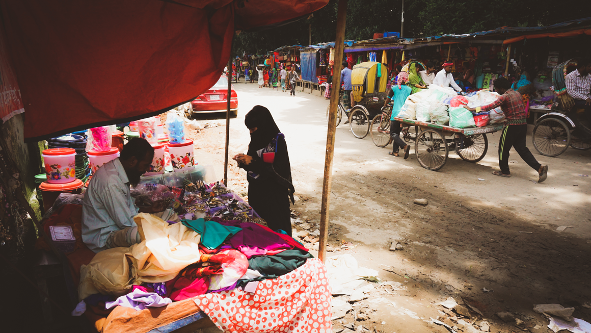 A street lined with sellers in Ershadnagar, one of the study communities. Image by Tasfiq Mahmood